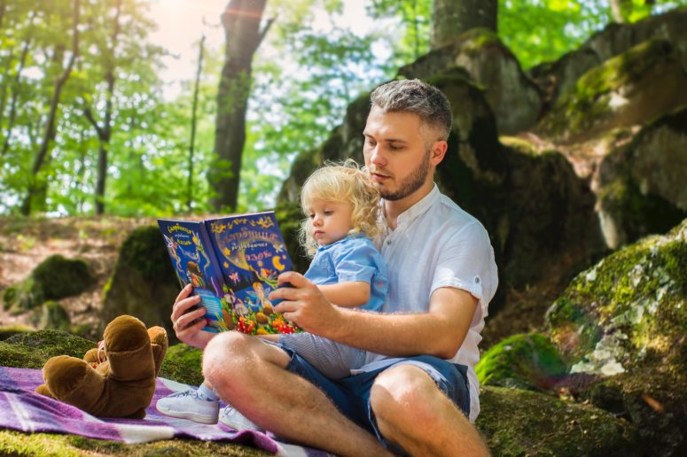 photo-of-man-and-child-reading-book-during-daytime-2801567