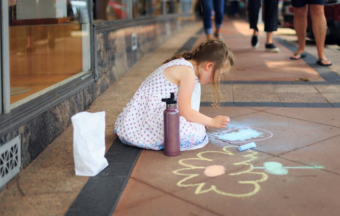 girl-drawing-on-the-floor-using-chalks-2414846