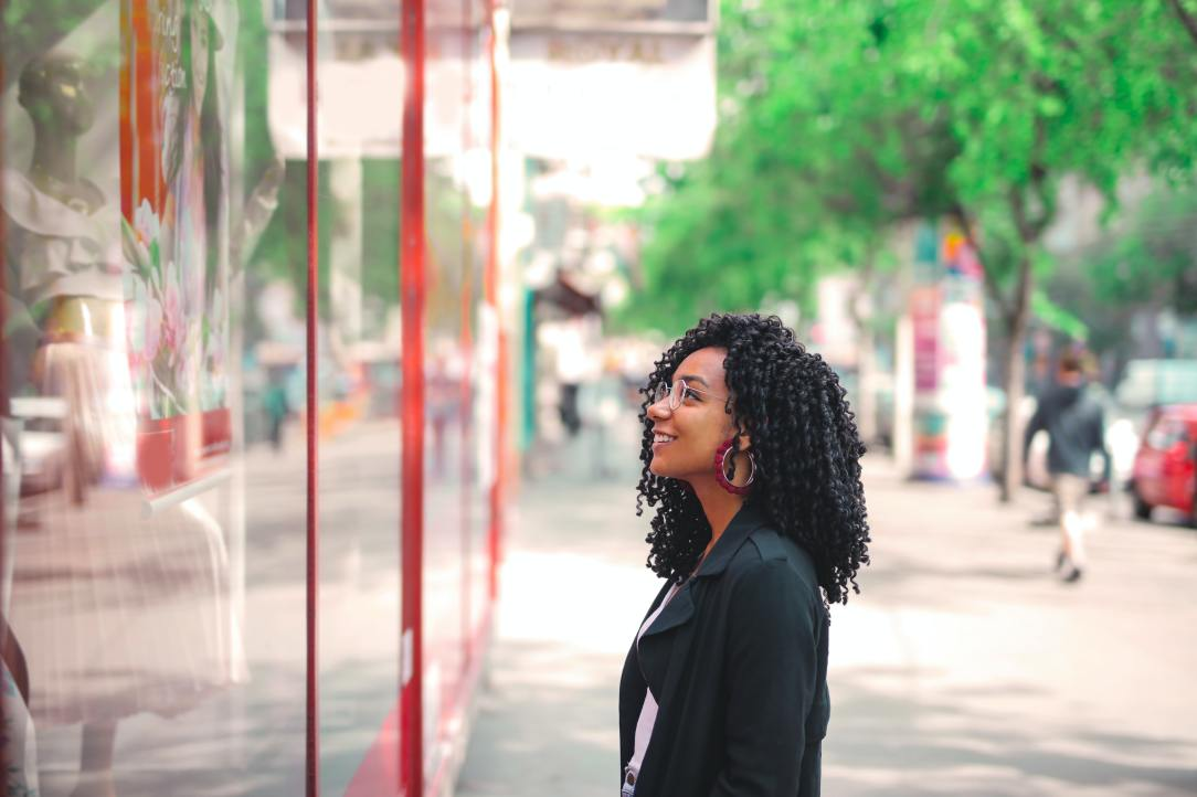 woman-in-black-coat-standing-on-sidewalk-3765160
